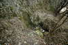 Zamek w Białym Kościele - Ślady wykutej studni u stóp skały zamkowej, fot. ZeroJeden, IV 2006